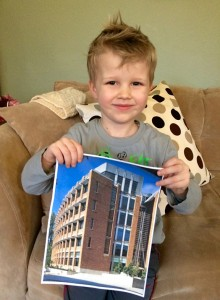Faculty member's son with photo of Allen Center
