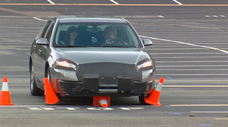 Car hitting traffic cones