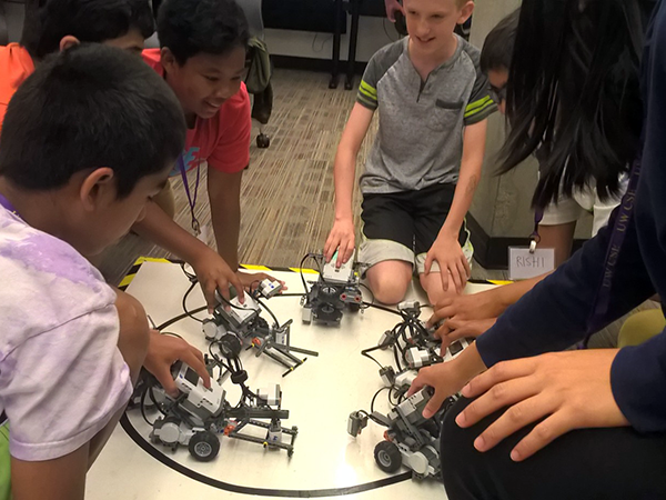 Group of campers playing robot games