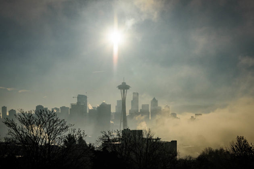 Clouds and sun over the Seattle skyline