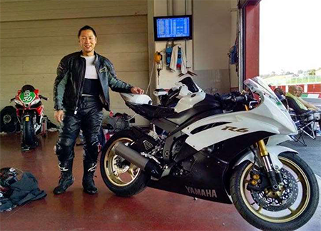 Jonathan Ko with a motorcycle at track day