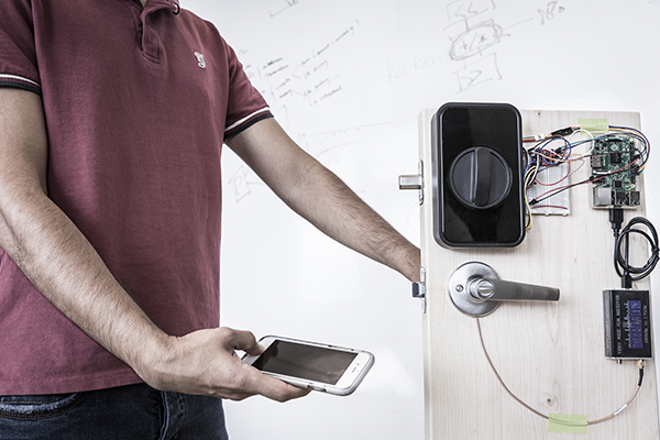 On-body transmission opens a smart lock using a phone's fingerprint sensor