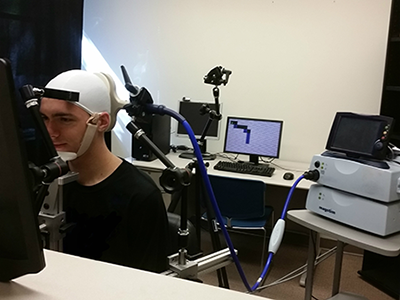 Research subject navigating a maze through direct brain stimulation