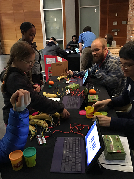 Students try an interactive demo at the 2016 Computing Open House