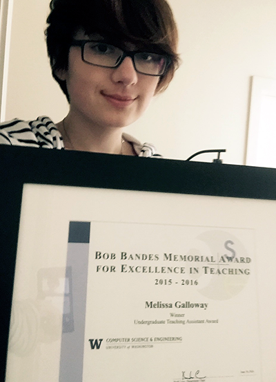 Melissa Galloway holding her teaching assistant award