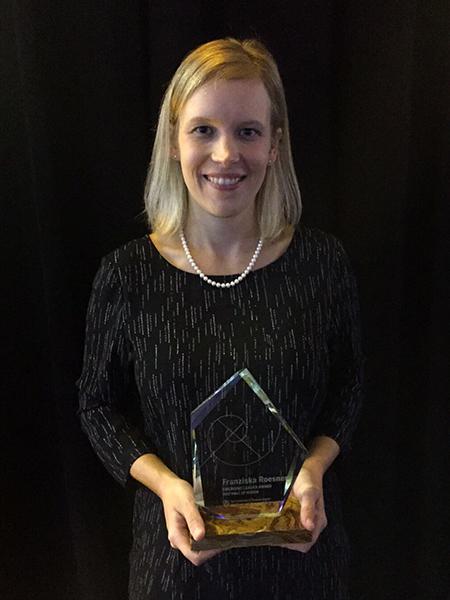 Franziska Roesner holding her Emerging Leader Award