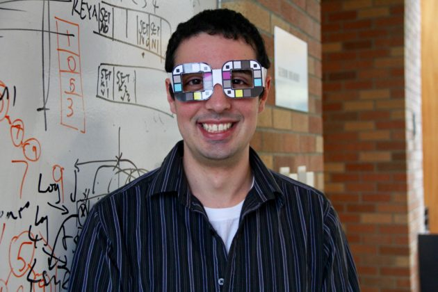 Alex Mariakakis in color-calibration glasses