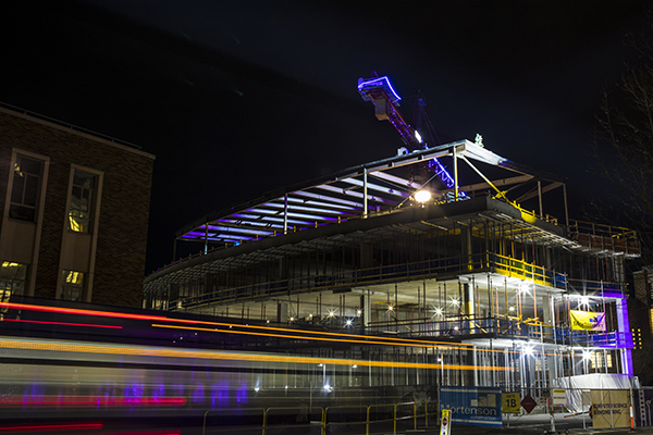 Shot of the Bill & Melinda Gates Center with final beam in place at night