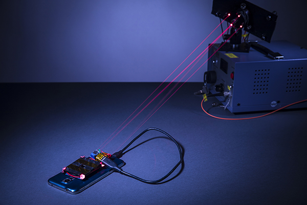 Demonstration of the laser wireless charging system with a smartphone