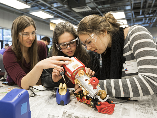 Volunteers adapt toys at a hackathon on the University of Washington campus