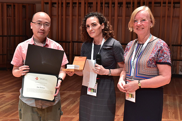 Yin Tat Lee onstage holding his award certification, with Simge Kucukyavuz and Karen Aardal