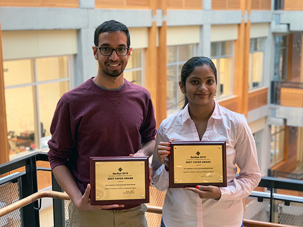 Vikram Iyer and Rajalakshmi Nandakumar holding their SenSys 2018 Best Paper Awards