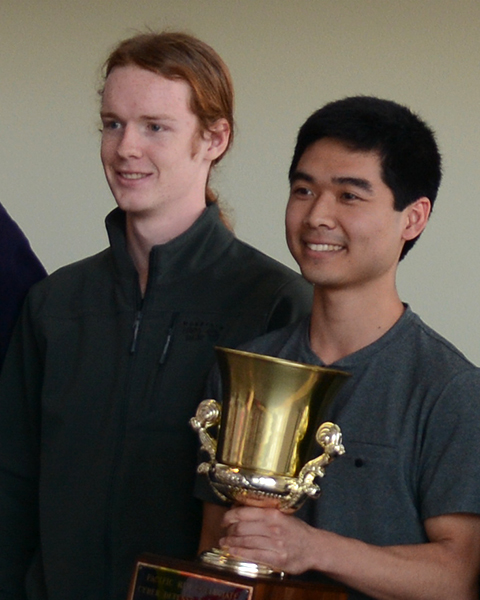 Rowan Phipps and Justin Inouye holding a trophy