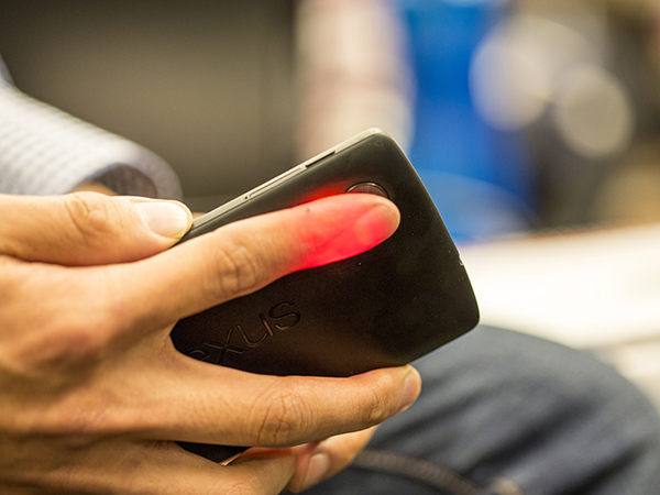 Demonstrating HemaApp using the smartphone camera to measure hemoglobin via an index finger
