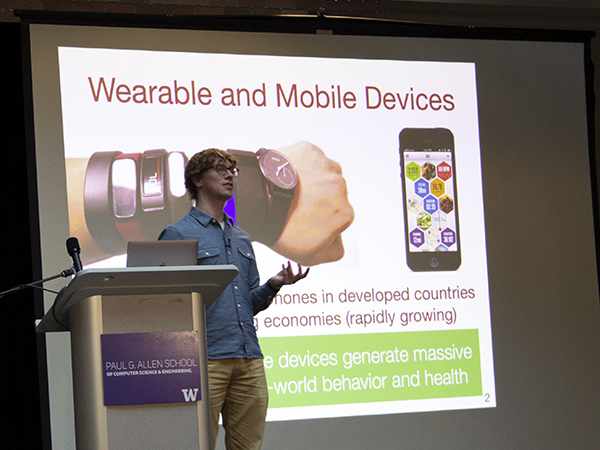 "Man standing in front of PowerPoint slide titled ""Wearable and Mobile Devices"""