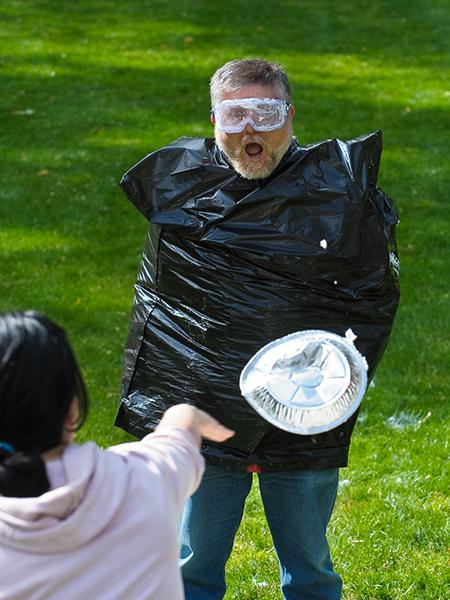 Gaetano Borriello wears a trash bag to protect his clothes from cream pie