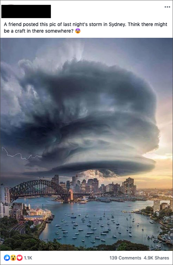 Dark, swirling clouds over an aerial shot of Sydney harbor and downtown