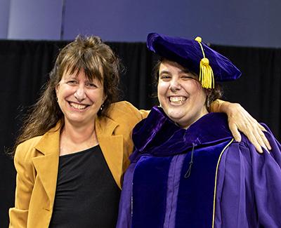 Anna Karlin and Kira Goldner, the latter wearing Ph.D. regalia